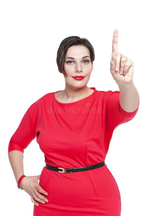 Mulher positiva do tamanho que faz a escolha isolada Foco disponível imagem de stock