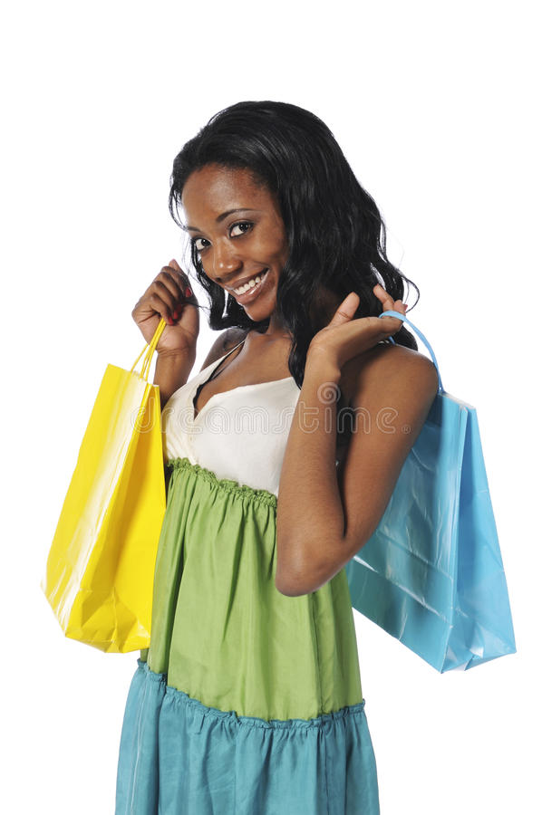 Mulher preta com sacos de compra foto de stock
