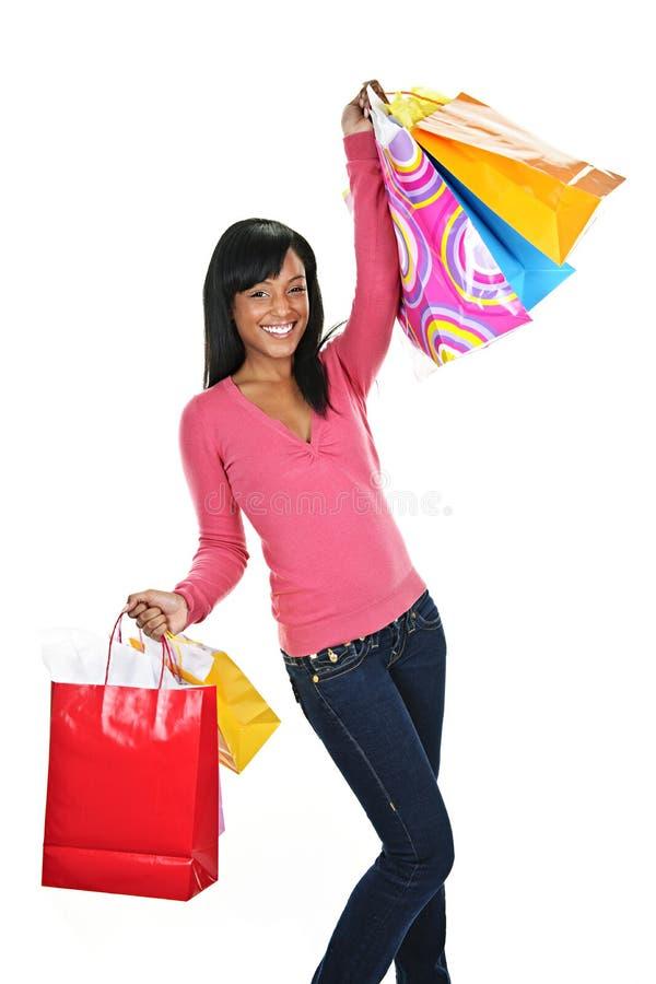 Mulher preta nova Excited com sacos de compra fotos de stock royalty free