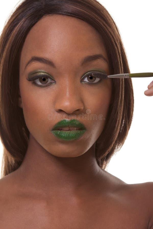 Mulher preta que anuncia a composição verde exótica fotos de stock