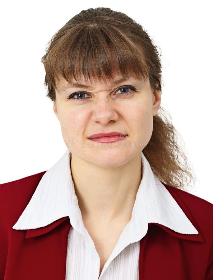 A mulher puxa uma face na careta da virada fotografia de stock royalty free