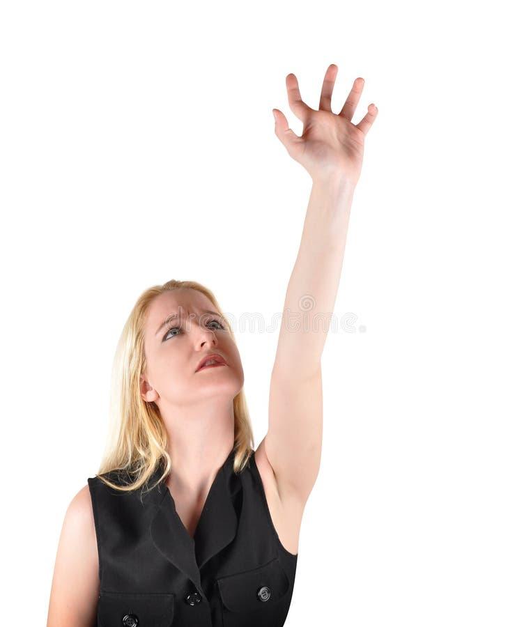 Mulher que alcanga acima no branco foto de stock royalty free