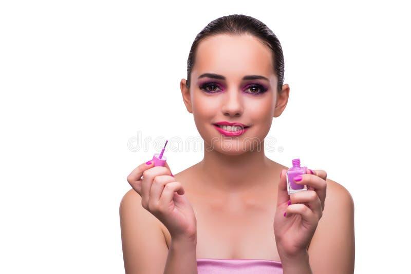 A mulher que aplica o batom isolado no branco foto de stock