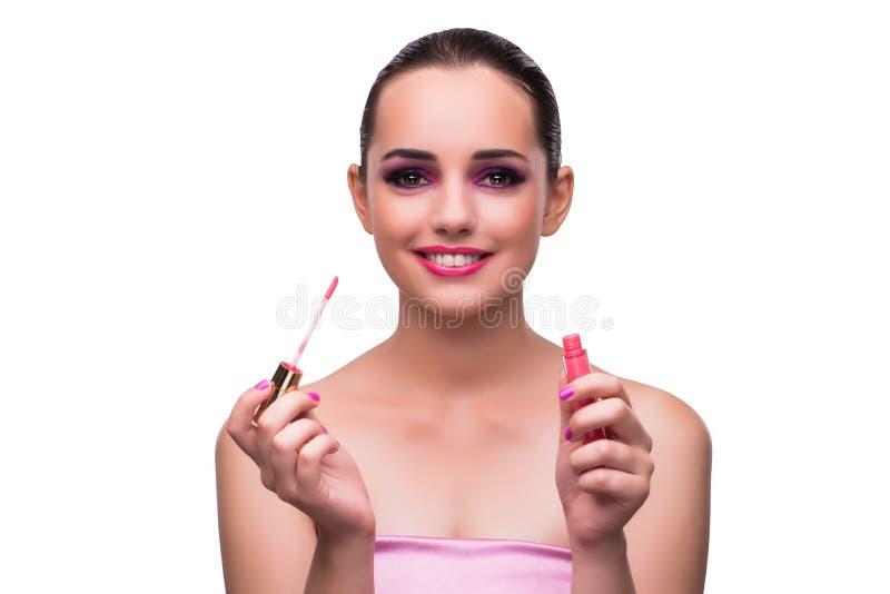 A mulher que aplica o batom isolado no branco foto de stock royalty free