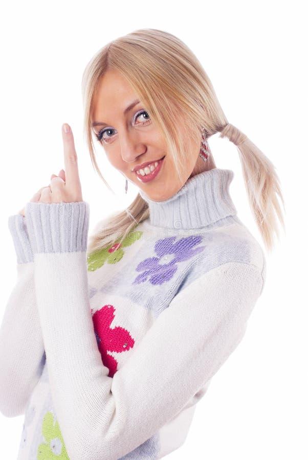 Mulher que aponta acima fotografia de stock