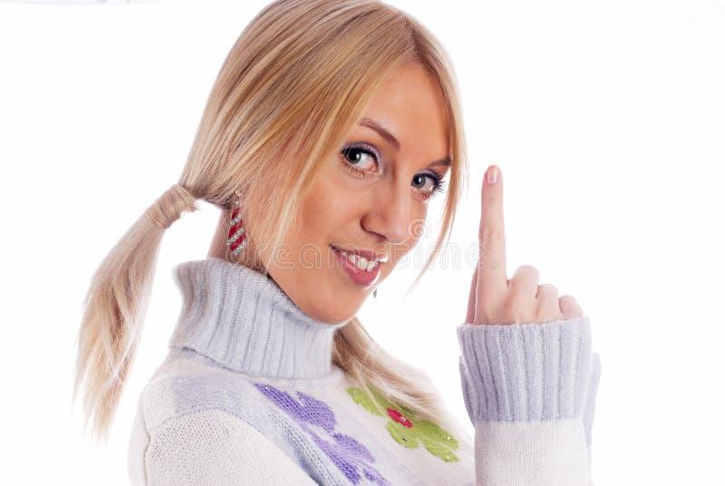 Mulher que aponta acima foto de stock