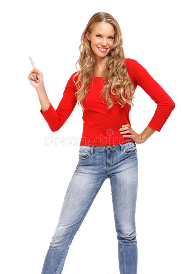 Mulher que aponta acima no copyspace no fundo branco foto de stock