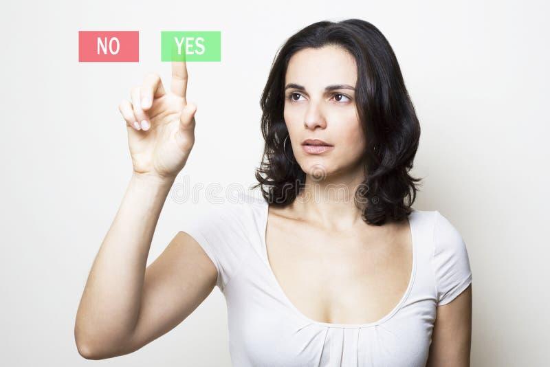 Mulher que aponta com a face triste no YES fotos de stock royalty free