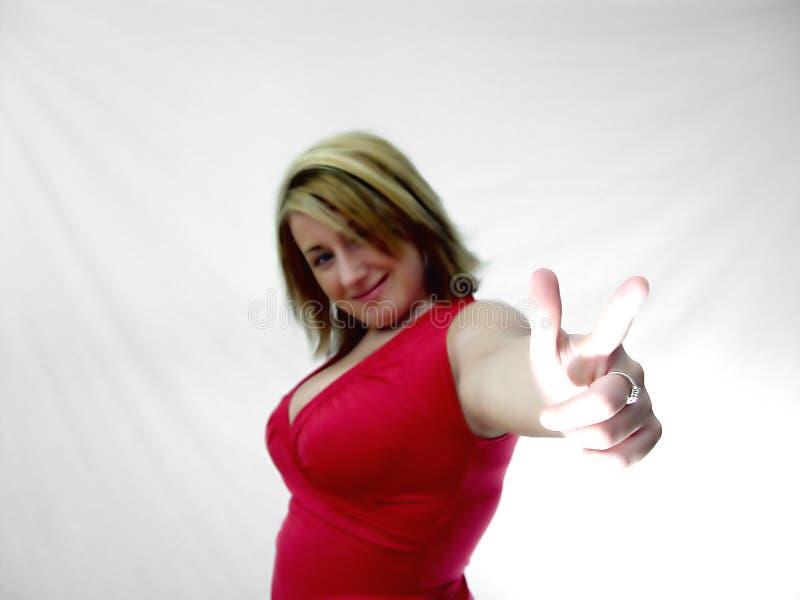 Mulher que aponta seu dedo imagem de stock