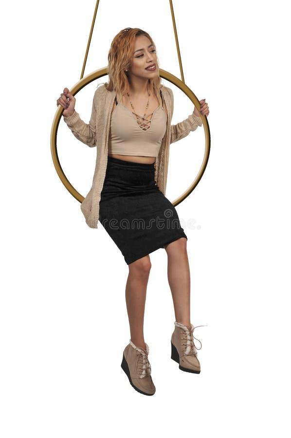 Mulher que balança no ar imagens de stock royalty free