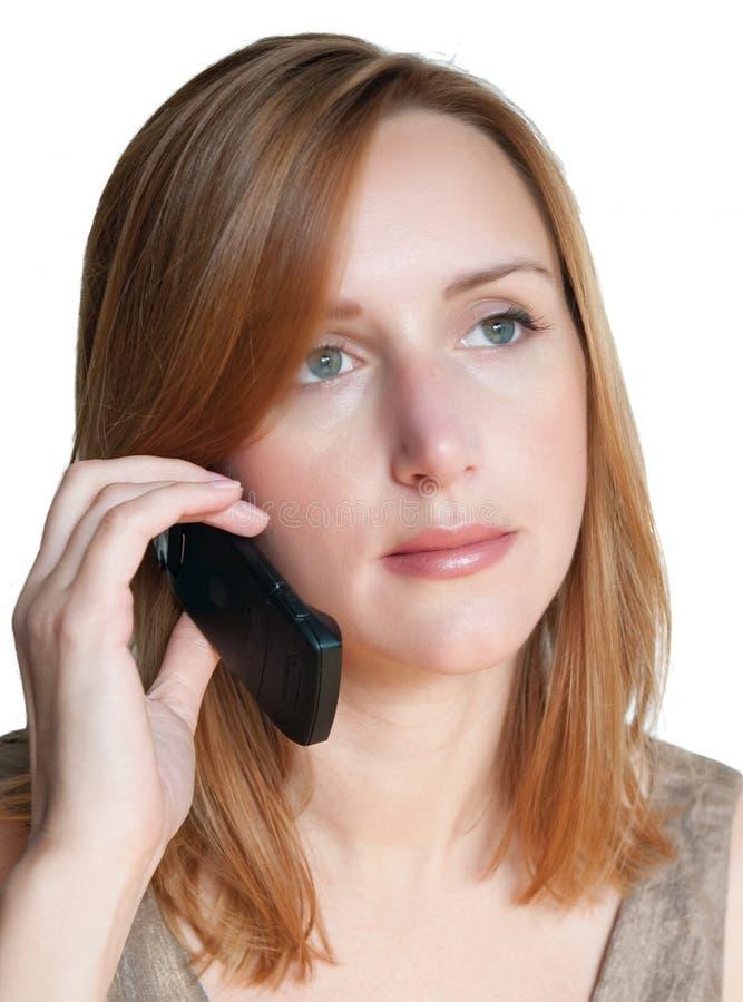 Mulher que chama pelo telefone imagens de stock