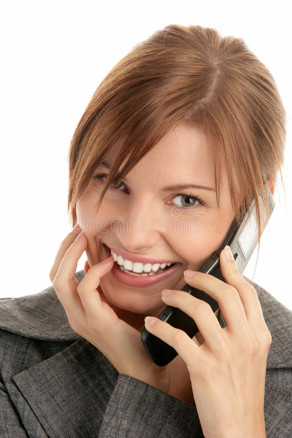Mulher que chama pelo telemóvel fotografia de stock royalty free