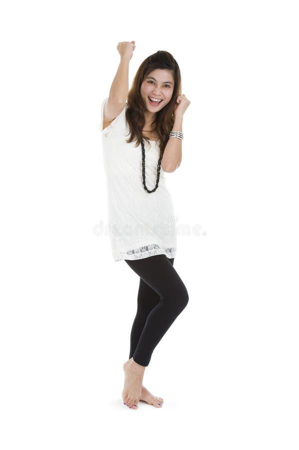 Mulher que cheering e que dança imagens de stock