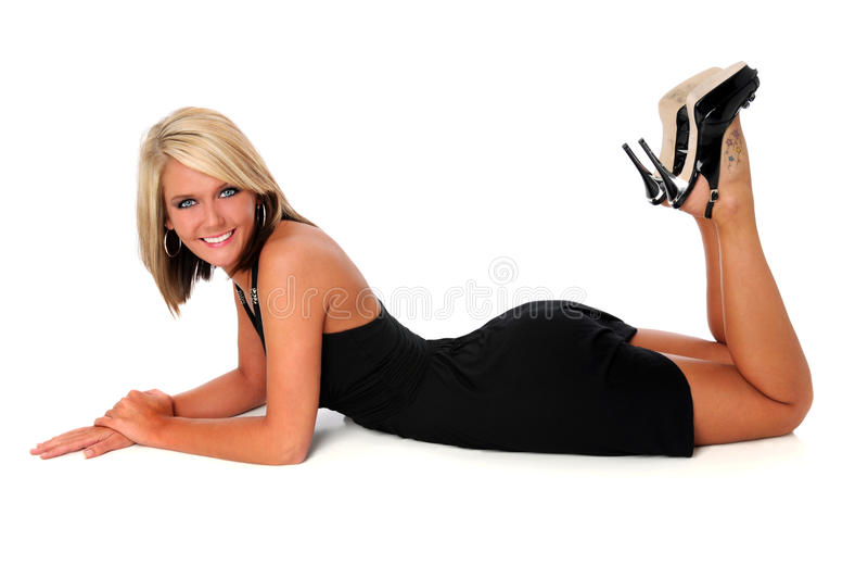 Mulher que coloca no assoalho fotografia de stock royalty free