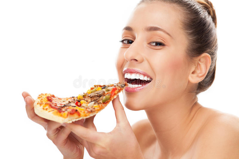 Mulher que come a fatia de pizza fotos de stock royalty free