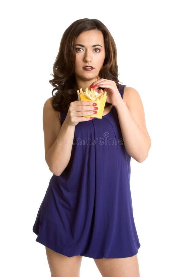 Mulher que come fritadas do francês fotografia de stock
