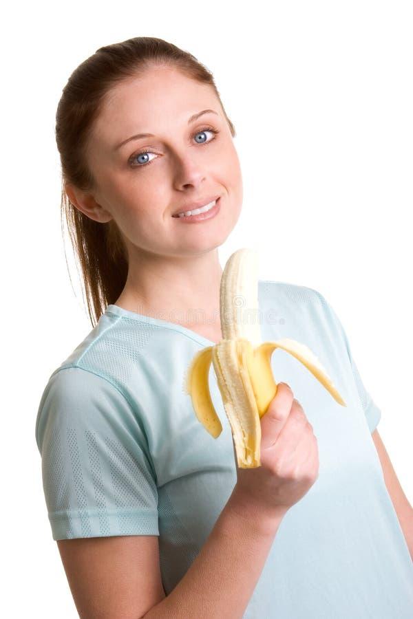 Mulher que come a fruta fotografia de stock royalty free