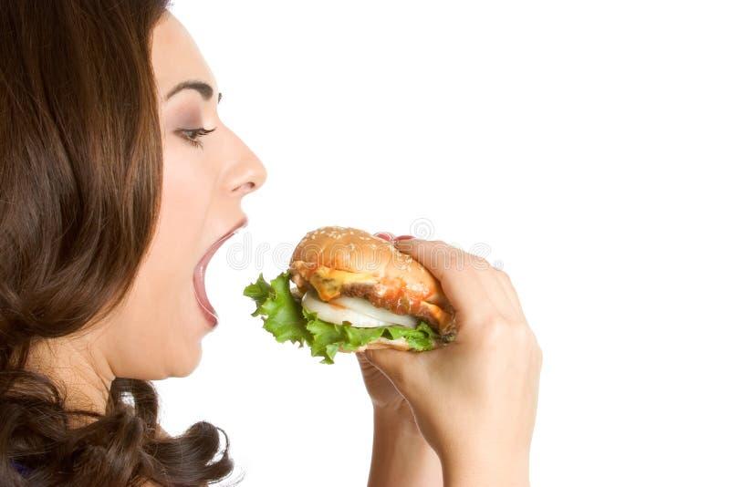 Mulher que come o alimento fotografia de stock royalty free