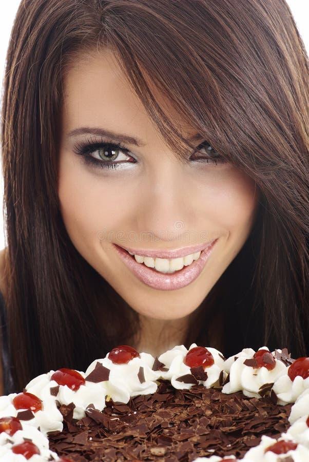 Mulher que come o bolo. foto de stock royalty free