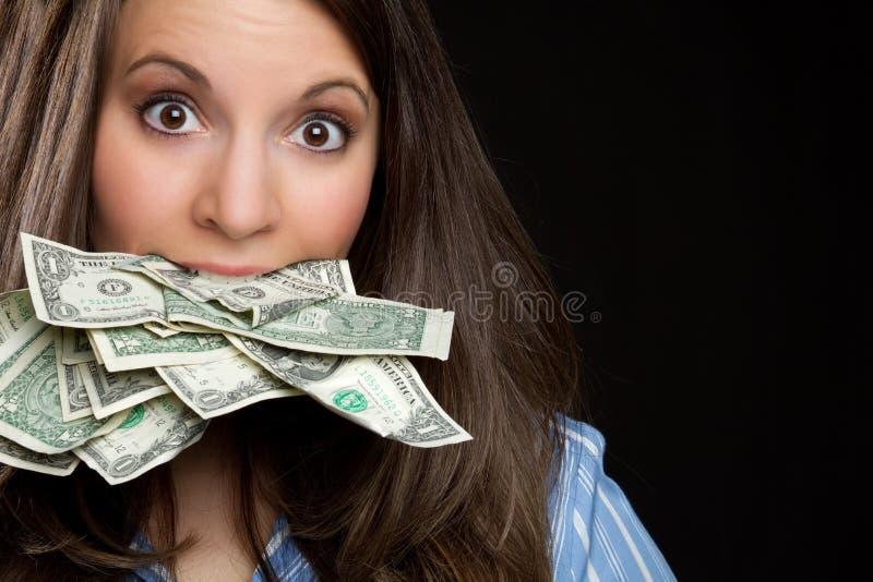 Mulher que come o dinheiro fotografia de stock royalty free