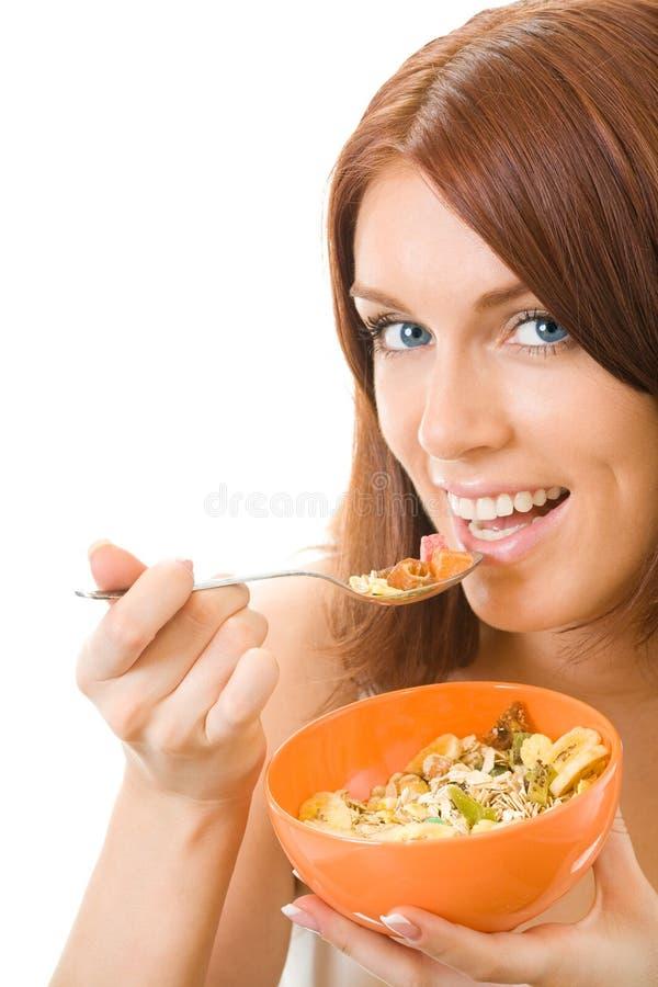 Mulher que come o muslin, isolado fotografia de stock royalty free