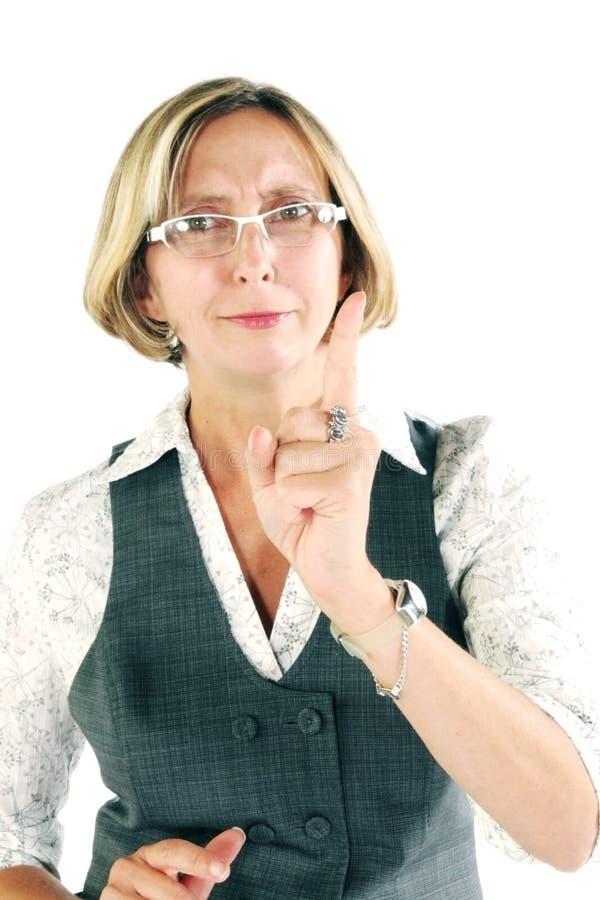 Mulher que dá a advertência foto de stock