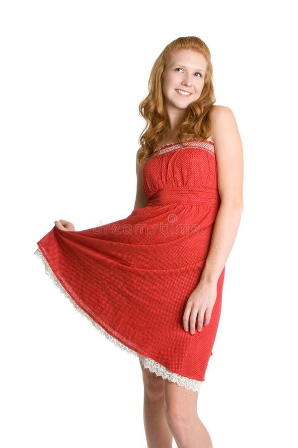 Mulher que desgasta o vestido vermelho fotos de stock