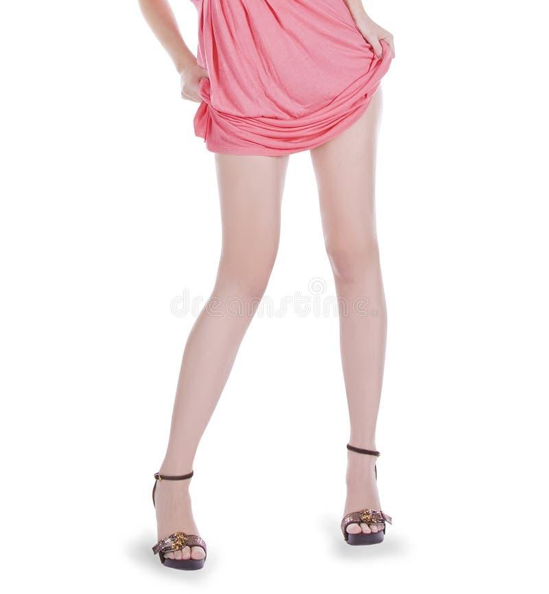mulher que desgasta um vestido cor-de-rosa fotos de stock