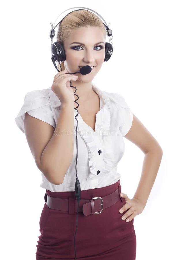 mulher que desgasta uns auriculares fotos de stock royalty free