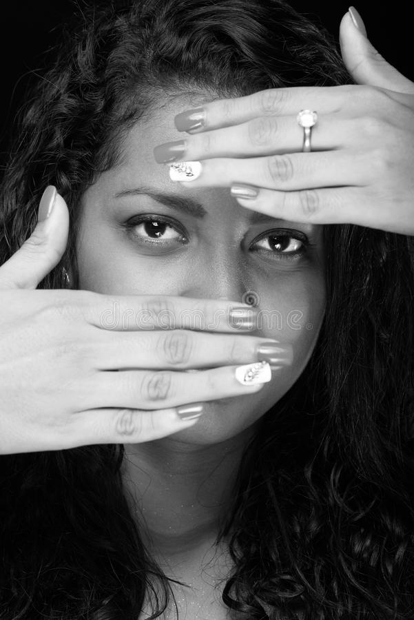 Mulher que esconde sua face foto de stock royalty free