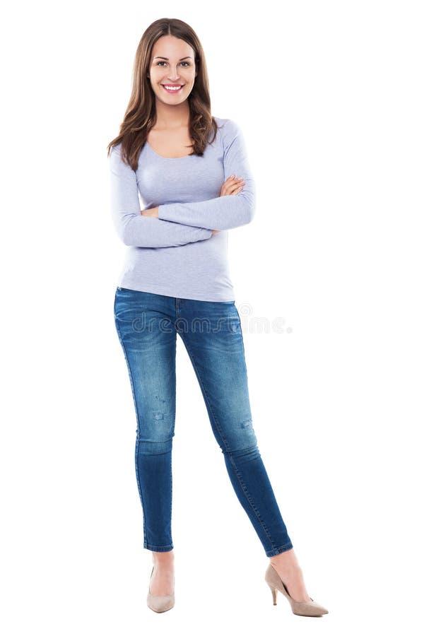 Mulher que está contra o fundo branco fotografia de stock royalty free