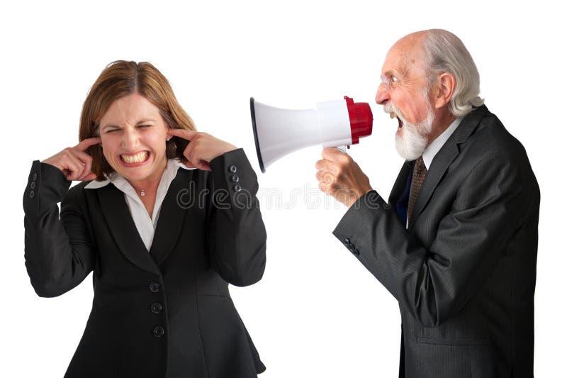 Mulher que está sendo gritada pelo gerente imagem de stock royalty free