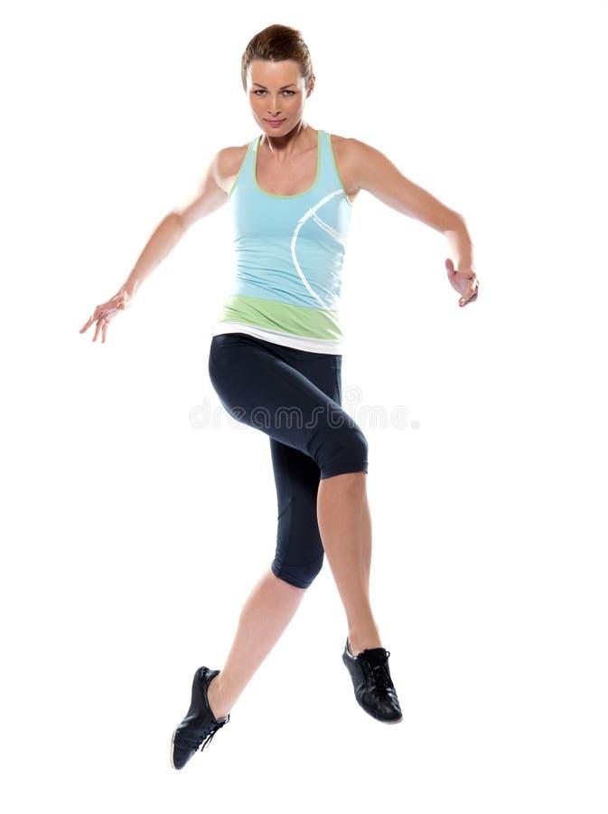 Mulher que exercita o salto runing do exercício imagens de stock royalty free