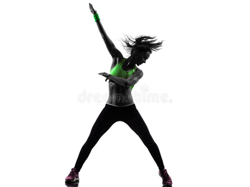 Mulher que exercita a silhueta da dança do zumba da aptidão fotos de stock