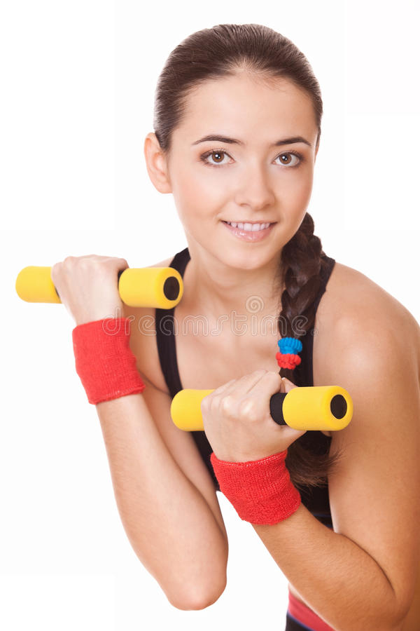 Mulher que faz exercícios para os bíceps imagem de stock royalty free
