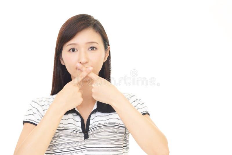 Mulher que faz o gesto do silêncio fotos de stock