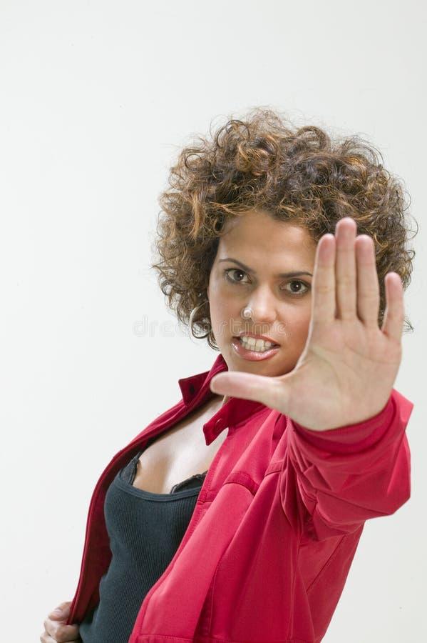 Mulher que faz o sinal do batente imagens de stock royalty free