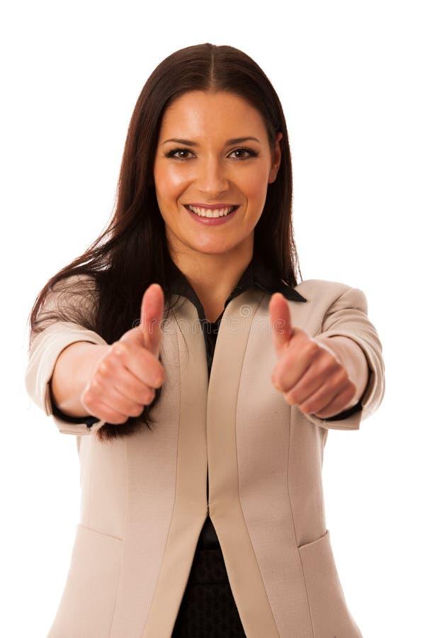 Mulher que gesticula o sucesso com polegares acima e sorriso feliz grande fotos de stock royalty free