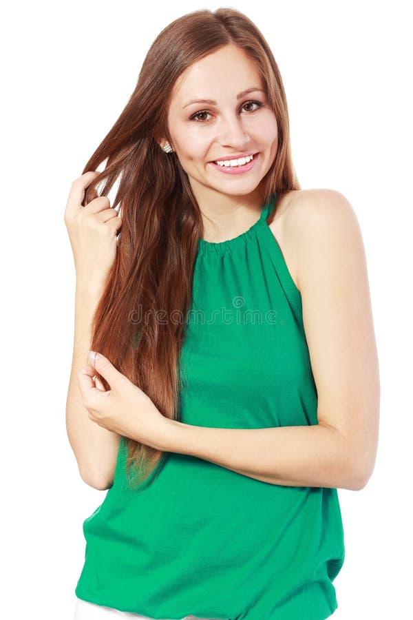 Mulher que guarda seu cabelo forte foto de stock royalty free