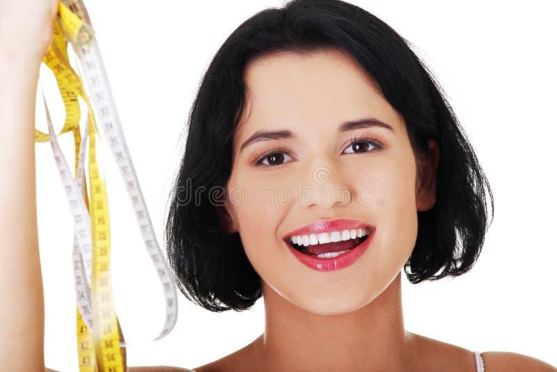 Download Mulher Que Guarda Tipos Da Medida - Foto de Stock - Imagem de modelo, atrativo: 29827248