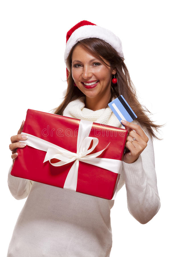 Mulher que guarda um cartão do presente e de banco do Natal imagem de stock