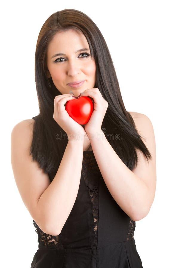 Mulher que guarda um coração em suas mãos imagem de stock royalty free