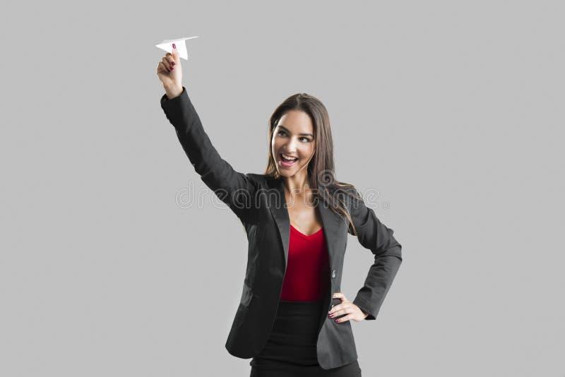 Mulher que joga um plano de papel imagens de stock