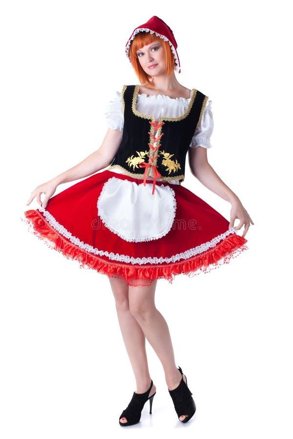 Mulher que levanta no traje de pouca capa de equitação vermelha imagens de stock royalty free