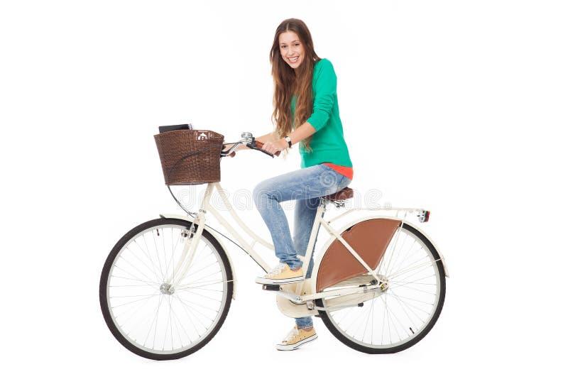 Mulher Que Monta Uma Bicicleta Fotografia de Stock Royalty Free