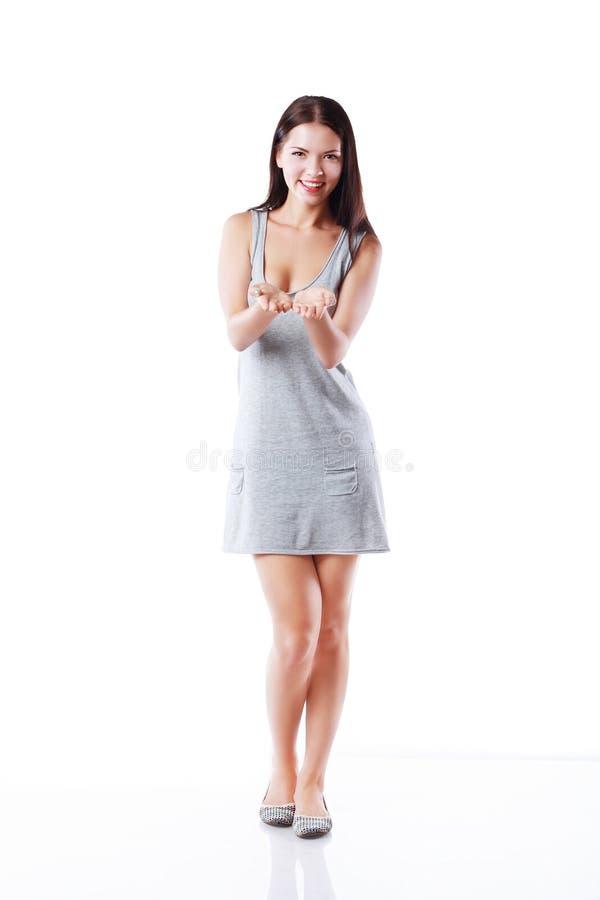 Mulher que mostra fotografia de stock