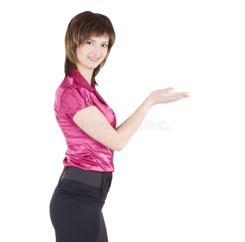 Mulher que mostra algo na palma de suas mãos fotos de stock royalty free