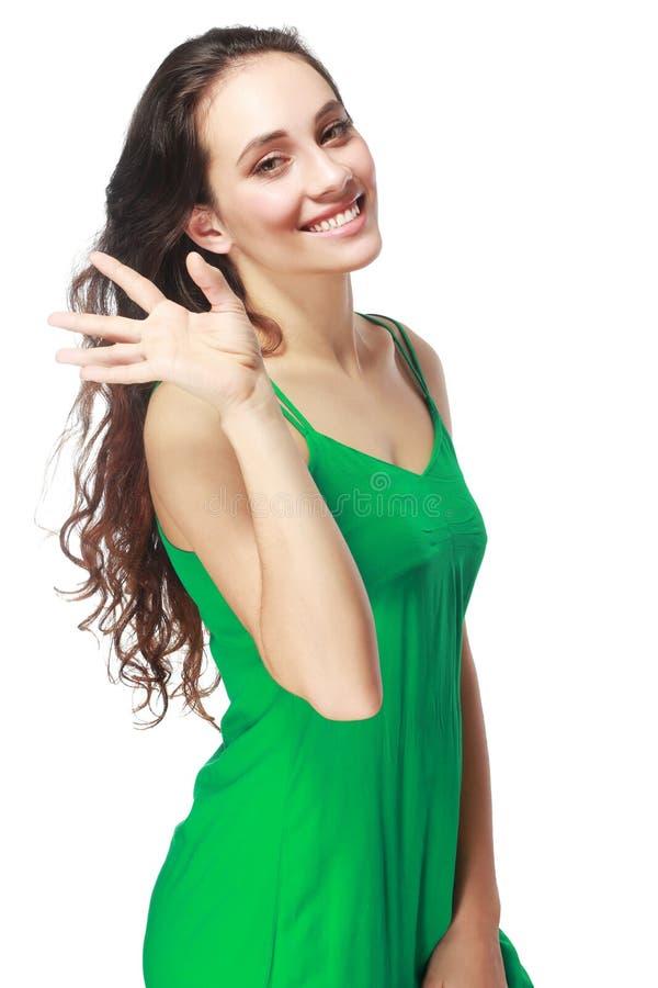 Mulher que mostra cinco dedos imagem de stock