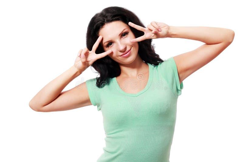 Mulher que mostra dois dedos fotos de stock