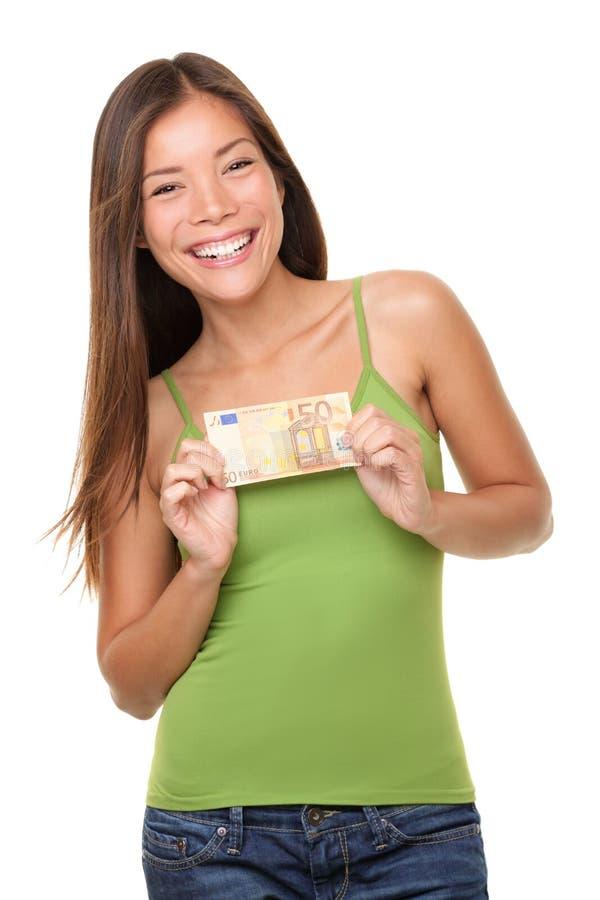 Mulher que mostra o euro- dinheiro foto de stock royalty free